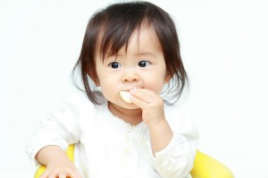 asian baby eating 497032104