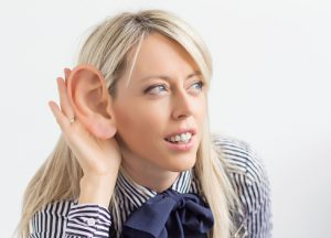 Woman listening with big ear