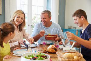 Family Enjoying Meal At Home Together